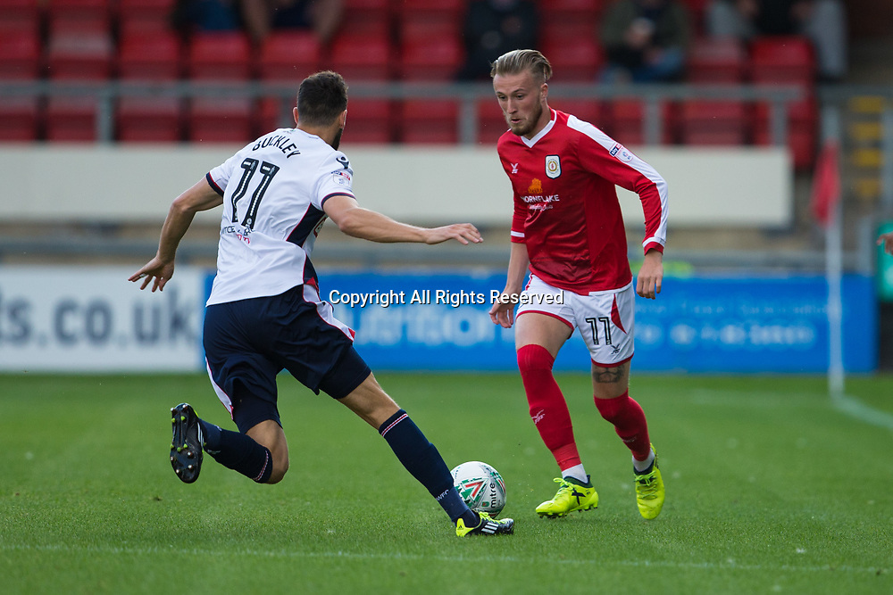 August 9th 2017, Gresty Road, Crewe, England; Carabao Cup First Round; Crewe Alexandra versus Bolton; Crewe Alexandra's George Cooper with his eye on the ball as Bolton Wanderers' Will Buckley goes in for the tackle
