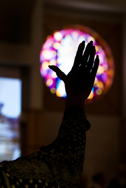 A congregant raises her hands in prayer during service at Zion Baptist Church in Madison, Wisconsin, Sunday, Feb. 4, 2018.