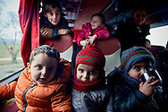 Iraqi children are Christians, living on the bus waiting to cross  crossing the Greece-Macedonian border, 8 Febraury 2016. Hundreds of refugees  wait every day at a gas station used as a temporary camp outside of Polykastro city at the north part of Greece until they receive the order from the police to move to the Greece- Macedonian border and continue their trip  to North Europe.
