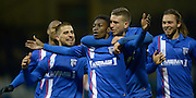 Gillingham's Jermain McGlashan is congratulated by Cody McDonald, Max Emher and Bradley Dack after scoring the opening goal  against Sheffield United, 7th February 2015.