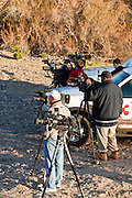 16 MARCH 2010 -- BUCKEYE, AZ: The media wait for Colorado in the Gila River bed after being rescued near Buckeye Tuesday morning. Colorado has spent the last several days marooned on a sandbar in the middle of the river after he and his owners were nearly swept downstream during a trail ride. PHOTO BY JACK KURTZ