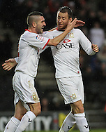 Picture by David Horn/Focus Images Ltd +44 7545 970036.26/12/2012.Dean Bowditch (right) of Milton Keynes Dons celebrates scroring with team mate Ryan Lowe (left) during the npower League 1 match at stadium:mk, Milton Keynes.