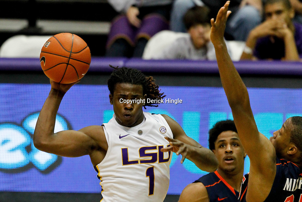 January 2, 2012; Baton Rouge, LA; LSU Tigers guard Anthony Hickey (1) passes as Virginia Cavaliers forward Akil Mitchell (25) and guard Jontel Evans (1) defend during the second half of a game at the Pete Maravich Assembly Center. Virginia defeated LSU 57-52.  Mandatory Credit: Derick E. Hingle-US PRESSWIRE