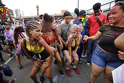 © Licensed to London News Pictures. 28/08/2016. London, UK. Dancers and children parade on family day of Notting Hill Carnival in west London, Sunday, 28 August 2016. Photo credit: Tolga Akmen/LNP
