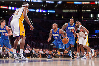 02 December 2012: Guard (14) Jameer Nelson of the Orlando Magic drives to the basket while being guarded by Dwight Howard of the Los Angeles Lakers during the first half of the Magic's 113-103 victory over the Lakers at the STAPLES Center in Los Angeles, CA.
