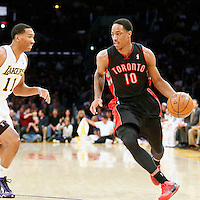 08 December 2013: Toronto Raptors shooting guard DeMar DeRozan (10) drives past Los Angeles Lakers shooting guard Wesley Johnson (11) during the Toronto Raptors 106-94 victory over the Los Angeles Lakers at the Staples Center, Los Angeles, California, USA.