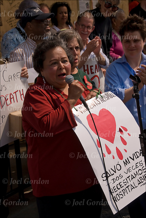Hispanic woman from the Hudson Guild Senior Program talking to Spanish crowd in at rally protest for the Coalition for a New Village Hospital  on 7th Avenue, committed to putting a hospital at the St. Vincent's site. She and other residents speak about how much St. Vincent's has meant to them, and how essential a full-service community hospital is the west side of New York.