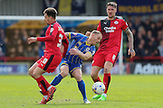 Barry Fuller (Captain) defender for AFC Wimbledon (2) is challenged by Crawley Town Midfielder Lyle Della (30) during the Sky Bet League 2 match between AFC Wimbledon and Crawley Town at the Cherry Red Records Stadium, Kingston, England on 16 April 2016. Photo by Stuart Butcher.