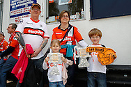 Luton Town fans with cardboard trophies before the Skrill Conference Premier match at Kenilworth Road, Luton<br /> Picture by David Horn/Focus Images Ltd +44 7545 970036<br /> 21/04/2014