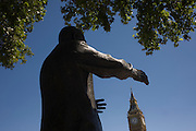 The reaching hands of ex-South African President Nelson Mandela's statue seemingly grasp the Big Ben clock tower in Parliament Square, Westminster, central London. On the day of the British general election where a hung parliament is a possibility, the fight for power of the nation appears to be an historic possibility.