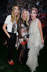 Left to right, CARA DELEVINGNE, ELLIE GOULDING and RITA ORA at the Glamour Women of the Year Awards in association with Pandora held in Berkeley Square Gardens, London on 4th June 2013.