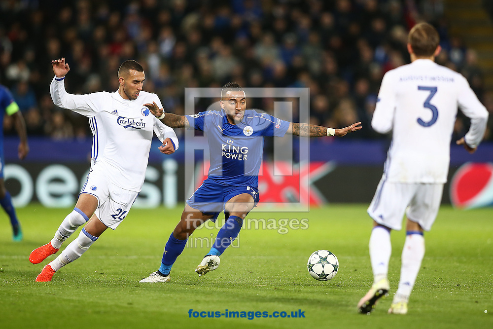 Danny Simpson of Leicester City (centre) holds off Youssef Toutouh of FC Copenhagen (left) during the UEFA Champions League match at the King Power Stadium, Leicester<br /> Picture by Andy Kearns/Focus Images Ltd 0781 864 4264<br /> 18/10/2016