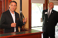Phillip L. Parker of the Dayton Area Chamber of Commerce (right) looks on as Ryan Roos of the NCR Country Club speaks during a Dayton Area Chamber of Commerce Business After Hours at the NCR Country Club in Kettering, Wednesday, July 25, 2012.  The Chamber will hold the 2012 Chamber Challenge, their 20th annual golf tournament and silent auction, at the NCR Country Club in September.