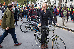 London, UK. 8 October, 2019. Dr Gail Bradbrook, co-founder of Extinction Rebellion, joins fellow climate activists blocking Whitehall on the second day of International Rebellion protests to demand a government declaration of a climate and ecological emergency, a commitment to halting biodiversity loss and net zero carbon emissions by 2025 and for the government to create and be led by the decisions of a Citizens' Assembly on climate and ecological justice.