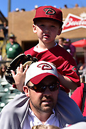 SCOTTSDALE, AZ - FEBRUARY 25:  A young Arizona Diamondbacks sits on hif fathers back prior to the spring training game against the Colorado Rockies at Salt River Fields at Talking Stick on February 25, 2017 in Scottsdale, Arizona.  (Photo by Jennifer Stewart/Getty Images)