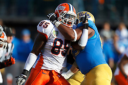 Dec 31, 2011; San Francisco CA, USA;  Illinois Fighting Illini defensive lineman Whitney Mercilus (85) is blocked by UCLA Bruins offensive tackle Mike Harris (right) during the second quarter at AT&T Park.   Illinois defeated UCLA 20-14. Mandatory Credit: Jason O. Watson-US PRESSWIRE