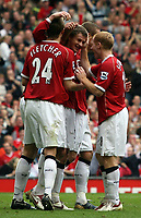 Photo: Paul Thomas.<br /> Manchester United v Newcastle United. The Barclays Premiership. 01/10/2006.<br /> <br /> Ole Gunnar Solskjaer (20) of Man Utd celebrates his goal with team mates.
