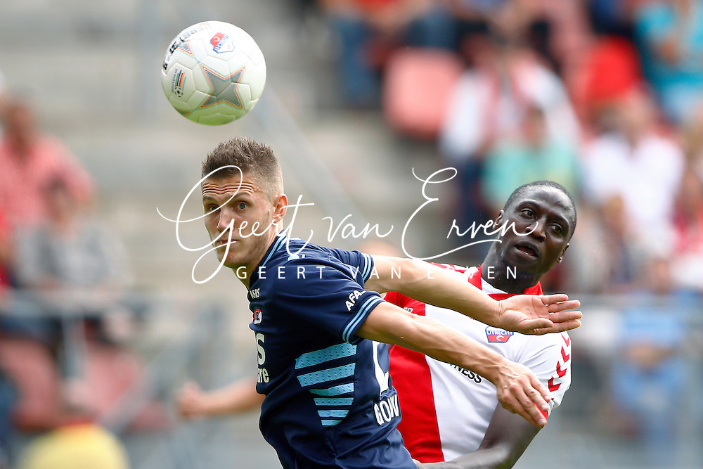 Onderwerp/Subject: FC Utrecht - AZ Alkmaar - Eredivisie<br /> Reklame:  <br /> Club/Team/Country: <br /> Seizoen/Season: 2013/2014<br /> FOTO/PHOTO: Jacob MULENGA (R) of FC Utrecht in duel with Jeffrey GOUWELEEUW (L) of AZ Alkmaar. (Photo by PICS UNITED)<br /> <br /> Trefwoorden/Keywords: <br /> #04 $94 &plusmn;1371811811150<br /> Photo- &amp; Copyrights &copy; PICS UNITED <br /> P.O. Box 7164 - 5605 BE  EINDHOVEN (THE NETHERLANDS) <br /> Phone +31 (0)40 296 28 00 <br /> Fax +31 (0) 40 248 47 43 <br /> http://www.pics-united.com <br /> e-mail : sales@pics-united.com (If you would like to raise any issues regarding any aspects of products / service of PICS UNITED) or <br /> e-mail : sales@pics-united.com   <br /> <br /> ATTENTIE: <br /> Publicatie ook bij aanbieding door derden is slechts toegestaan na verkregen toestemming van Pics United. <br /> VOLLEDIGE NAAMSVERMELDING IS VERPLICHT! (&copy; PICS UNITED/Naam Fotograaf, zie veld 4 van de bestandsinfo 'credits') <br /> ATTENTION:  <br /> &copy; Pics United. Reproduction/publication of this photo by any parties is only permitted after authorisation is sought and obtained from  PICS UNITED- THE NETHERLANDS