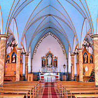 Nave of Immaculate Conception Church in Frutillar, Chile<br /> Except for its spire, the outside of the Parish Church of the Immaculate Conception is humble in design. But inside it is a delightful surprise. The pale blue rib vault is a beautiful canopy accenting the statue of the Virgin Mary behind the altar.