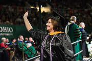 Debra Cox waves to supporters atfter receiving her Masters in Nursing degree. Photo by Ben Siegel