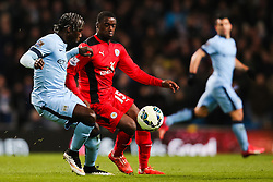 Manchester City's Bacary Sagna and Jeff Schlupp of Leicester City  - Photo mandatory by-line: Matt McNulty/JMP - Mobile: 07966 386802 - 04/03/2015 - SPORT - football - Manchester - Etihad Stadium - Manchester City v Leicester City - Barclays Premier League