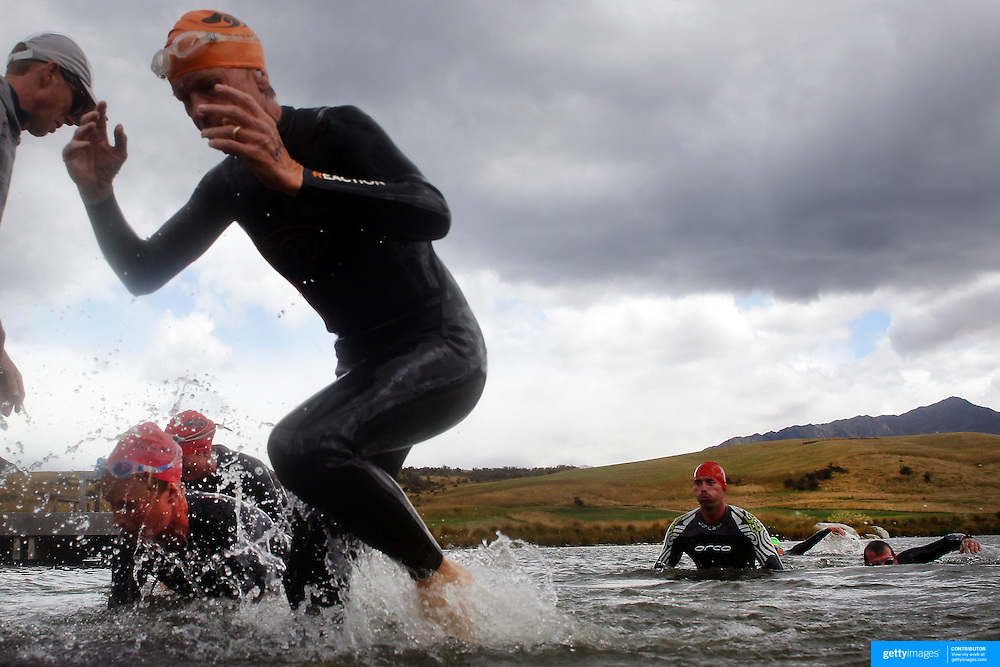 Competitors leave the water after the swim leg during the Active Q T Ultimate Tri Series Jack's Point Triathlon, Jack's Point, Queenstown, Otago, New Zealand. 14th January 2012. Photo Tim Clayton