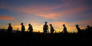 Oregon National Guard soldiers from Team Alpha make their way up towards the Sheldon Ridge as they lay hose for several miles on their first night out on the fire lines.