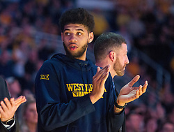 Feb 20, 2017; Morgantown, WV, USA; West Virginia Mountaineers forward Esa Ahmad (23) claps before the game while he sits out the game due to an injury at WVU Coliseum. Mandatory Credit: Ben Queen-USA TODAY Sports
