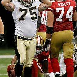 August 12, 2011; New Orleans, LA, USA; New Orleans Saints defensive tackle Mitch King (75) reacts after recording a sack against the San Francisco 49ers during the first half of a preseason game at the Louisiana Superdome. Mandatory Credit: Derick E. Hingle