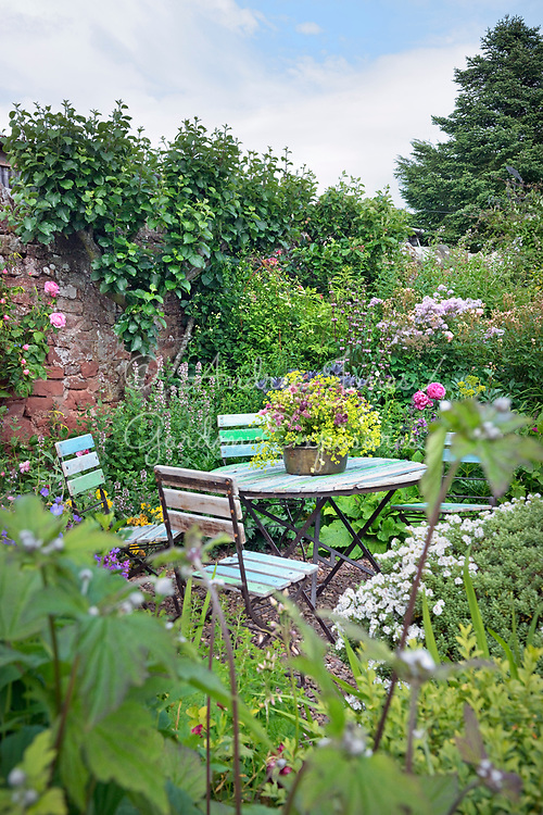 Patio table and chairs in sheltered are of the walled garden