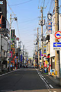 Early morning in a Japanese city street. Hirosaki city Japan. Like most of Japan there are electrical wires all over the place.