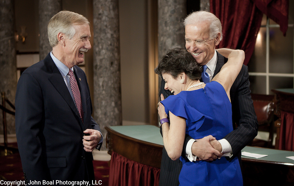 Mary J. Herman and Vice President Joe Biden exchange a big hug and a laugh on the floor of the Old Senate Chamber in the U.S. Capitol moments before Angus King (I-ME) and Biden perform a re-enactment of the swearing-in ceremony for gathered media, on Thursday, January 3, 2013. For The Portland (ME) Press-Herald.