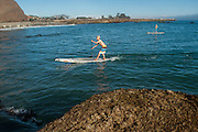Kai McPhillips paddleboarding at Dana Point, California.