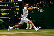 LONDON, ENGLAND - JULY 6: Novak Djokovic of Serbia in action during the Gentlemens' Singles final match against Roger Federer of Switzerland on day thirteen of the Wimbledon Lawn Tennis Championships at the All England Lawn Tennis and Croquet Club at Wimbledon on July 6, 2014 in London, England.