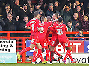 Crawley's Richard Wood celebrates his opening goal during the Sky Bet League 1 match between Crawley Town and Sheffield Utd at the Checkatrade.com Stadium, Crawley, England on 28 February 2015. Photo by Phil Duncan.