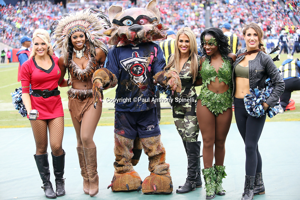 A group of Tennessee Titans cheerleaders dressed in Halloween costumes pose for a group photo with team mascot T-Rac during the Tennessee Titans 2015 week 7 regular season NFL football game against the Atlanta Falcons on Sunday, Oct. 25, 2015 in Nashville, Tenn. The Falcons won the game 10-7. (©Paul Anthony Spinelli)