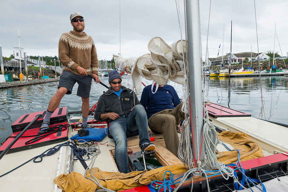 Race to Alaska: <br /> <br /> Racers gathered this week and prepped today in Port Townsend WA for the &quot;R2AK&quot; in which human and wind powered boasts (or a combination of the two) compete in a race to Alaska that may take some 10-12 days and others nearly 3-4 weeks.<br /> <br /> HERE: Michael Dougherty, standing, and Sameer Rayachoti, sitting at pedaling station, do a quick test cruise in the Port Townsend harbor. (Also in boat is Matt Johnson, who will sail the first leg with them tomorrow to Victoria BC) Their catamaran has two pedaling stations also, for additional power when there's  low wind.<br /> <br /> Photo: Patrick Downs