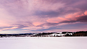 Magenta-purple skies and clouds at sunrise nearby to Millarville, Alberta,located southwest of Calgary.