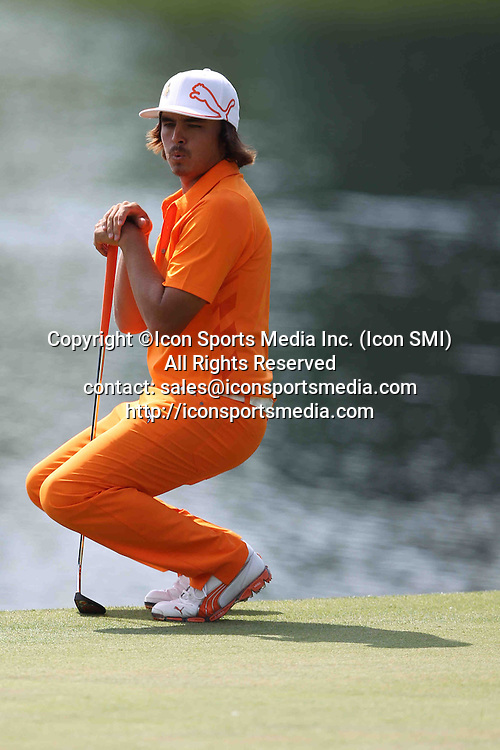 06 May 2012: Rickie Fowler reacts to an errant putt on 14 during final round action at the the Wells Fargo Tournament at Quail Hollow Country Club, Charlotte, North Carolina. Rickie Fowler wins the tournament in a three-way playoff again D.A. Points and Rory McIlroy.