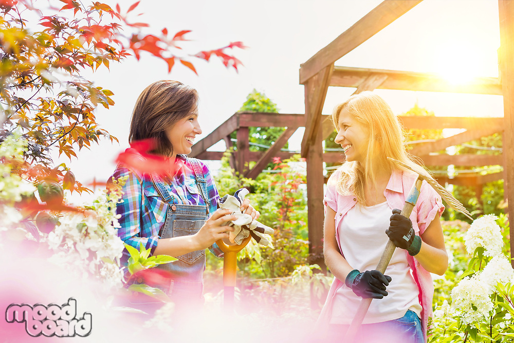 Portrait of mature female gardeners standing while talking