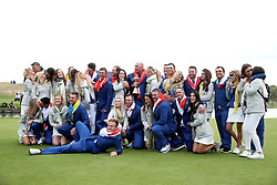 Team Europe captain Thomas Bjorn celebrates with the Ryder Cup trophy alongside players and their wives and girlfriends on day three of the Ryder Cup at Le Golf National, Saint-Quentin-en-Yvelines, Paris.