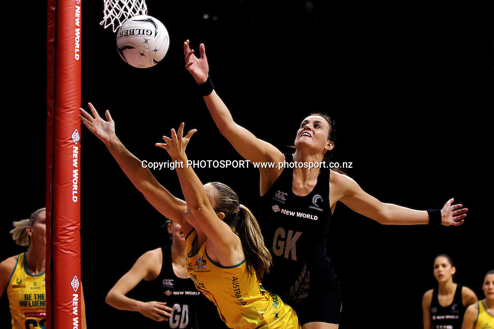 Silver Fern's Leana de Bruin tips the ball away against Australia's Susan Pratley. New World Quad Series, New Zealand Silver Ferns v Australian Diamonds at Claudelands Arena, Hamilton, New Zealand. Thursday 1st November 2012. Photo: Anthony Au-Yeung / photosport.co.nz