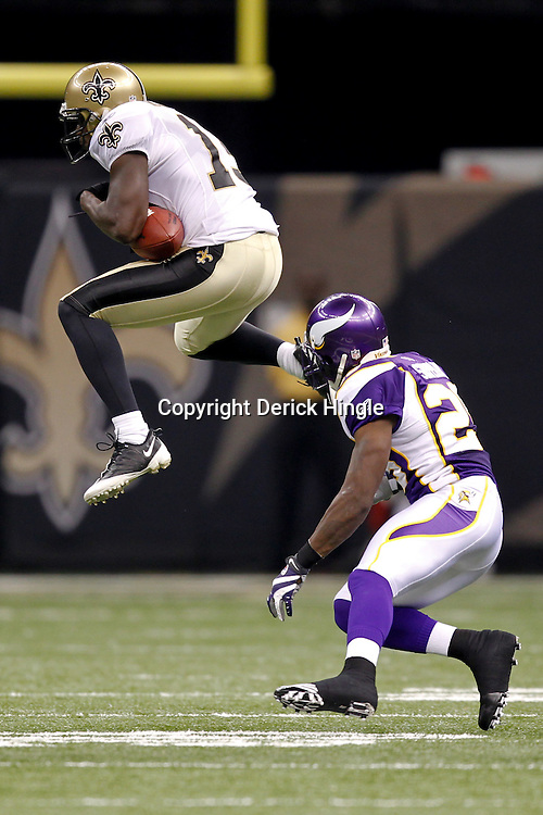 September 9, 2010; New Orleans, LA, USA;  New Orleans Saints wide receiver Devery Henderson (19) drops a pass in front Minnesota Vikings cornerback Lito Sheppard (29) during the NFL Kickoff season opener at the Louisiana Superdome. The New Orleans Saints defeated the Minnesota Vikings 14-9.  Mandatory Credit: Derick E. Hingle