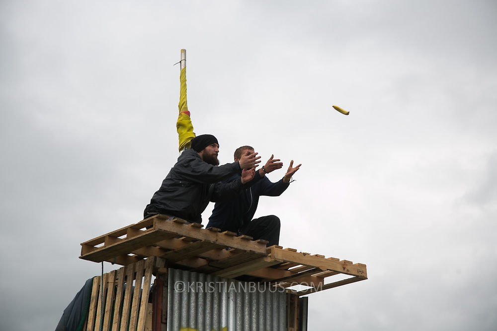 Anti-fracking  activists and protesters outside the gates of Quadrilla's fracking site June 31st, Lancashire, United Kingdom. Activists up a make-shift tower receives foodsupplies. The struggle against fracking in Lancashire has been going on for years. The fracking company Quadrilla is finally ready to bring in a drill tower to start drilling and anti-frackinhg activists are waiting in front of the gates to block the equipment getting in.