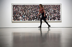 © Licensed to London News Pictures. 24/01/2018. London, UK. Photograph titled May Day IV, 2000, by artist ANDREAS GURSKY is on display as part the first major UK retrospective of the German photographer. The showcase also marks the Haywood galleries 50th anniversary following its two year refurbishment. Photo credit: Ray Tang/LNP