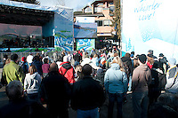 Fans watch the luge race on the large screen TV in Village Square during the 2010 Olympic Winter Games in Whistler, BC Canada.