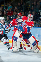 KELOWNA, CANADA -JANUARY 29: Garret Hughson G #30 of the Spokane Chiefs clears the puck out of the zone against the Kelowna Rockets on January 29, 2014 at Prospera Place in Kelowna, British Columbia, Canada.   (Photo by Marissa Baecker/Getty Images)  *** Local Caption *** Garret Hughson;