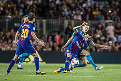 August 13, 2017 - Barcelona, Catalonia, Spain - FC Barcelona midfielder SERGIO competes with Real Madrid midfielder KROOS for the ball during the Spanish Super Cup Final 1st leg between FC Barcelona and Real Madrid at the Camp Nou stadium in Barcelona (Credit Image: © Matthias Oesterle via ZUMA Wire)