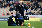 Derby County goalkeeper Scott Carson receives treatment during the Sky Bet Championship match between Wolverhampton Wanderers and Derby County at Molineux, Wolverhampton, England on 27 February 2016. Photo by Alan Franklin.