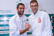 (L) Marin Cilic of Croatia & (R) Jerzy Janowicz of Poland while official draw at Regent Hotel one day before the BNP Paribas Davis Cup 2014 between Poland and Croatia at Torwar Hall in Warsaw on April 3, 2014.<br /> <br /> Poland, Warsaw, April 3, 2014<br /> <br /> Picture also available in RAW (NEF) or TIFF format on special request.<br /> <br /> For editorial use only. Any commercial or promotional use requires permission.<br /> <br /> Mandatory credit:<br /> Photo by © Adam Nurkiewicz / Mediasport